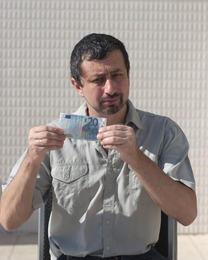 Euro geld ter beschikking van de bedrijfsmens royalty-vrije stock afbeelding