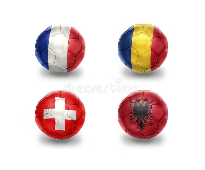 Euro groupe A boules du football avec les drapeaux nationaux des Frances, Roumanie, Suisse, Albanie illustration libre de droits