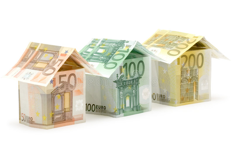 Euro Houses. Three colorful houses built of different euro bills. Isolated on a white background royalty free stock images