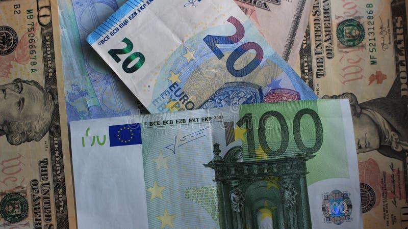 Euro i dolary na stole fotografia stock