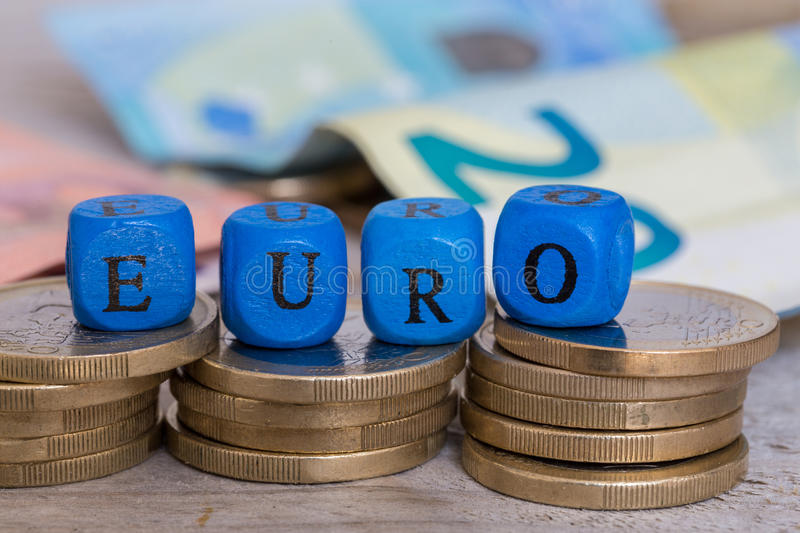 Euro letter cubes on coins concept royalty free stock image