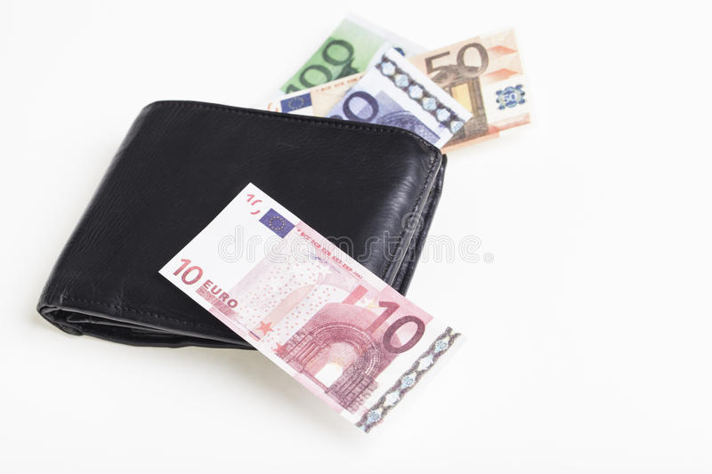 Euro loss. Black purse with miniature play money euro banknotes on a white background. Financial concept for capital loss and inflation stock photo