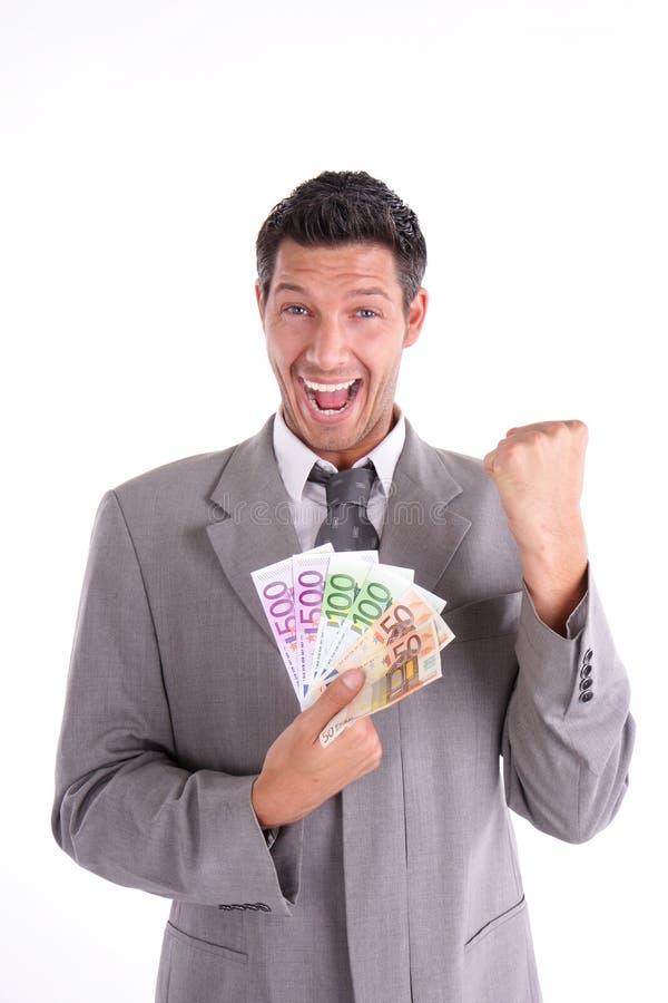 Euro lottery. Happy lottery win man with euros stock photography