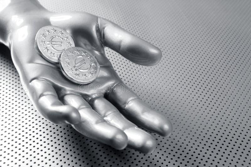 Euro- mão futurista da prata de moeda do negócio fotografia de stock royalty free