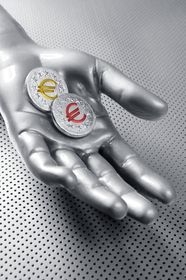 Euro- mão futurista da prata de moeda do negócio foto de stock