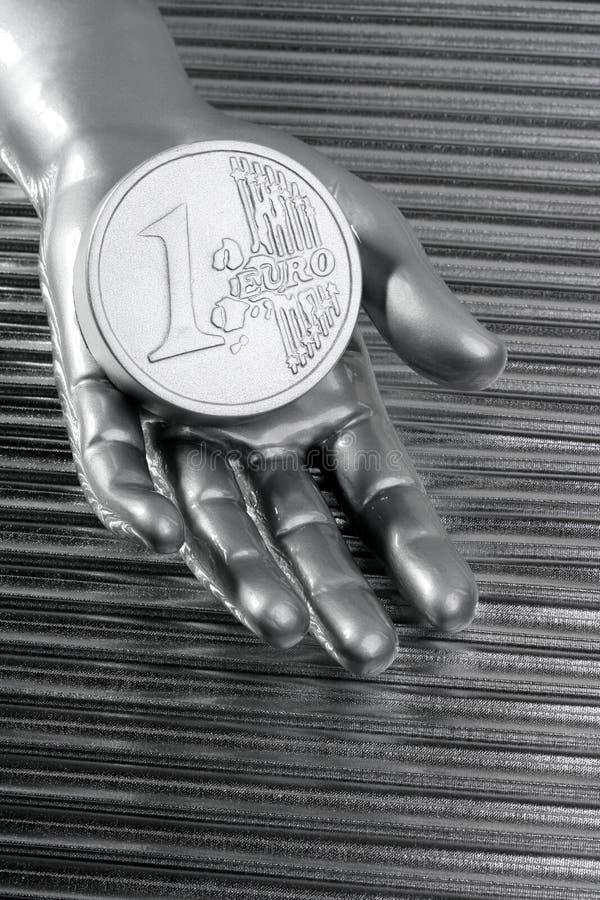Euro- moeda de prata da mão metálica futurista fotografia de stock