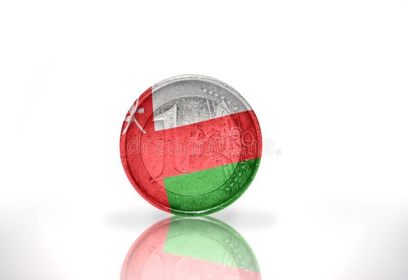 euro moneta con la bandiera dell'Oman sul bianco fotografia stock