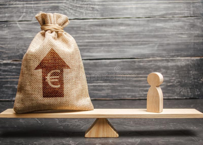 Euro money bag with up arrow and man figurine on scales. The average salary in the labor market, pricing. Criteria royalty free stock photography
