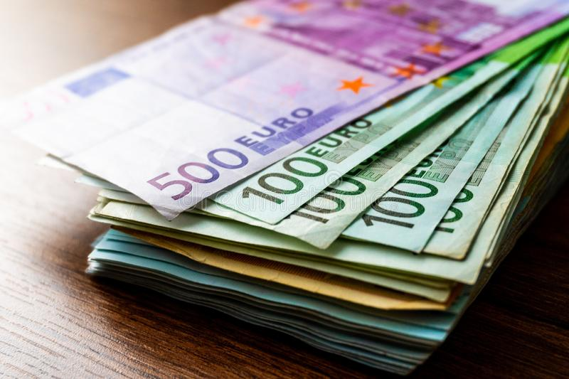 Euro Money Banknotes. Euro banknotes as part of the united country`s payment system. Currency. Cash pile of money on the table. Th stock images