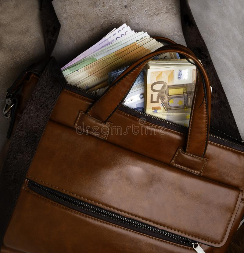Euro Money Banknotes in suitcase isolated on white background top view. Euro bills in open suitcase. Euro cash background stock images