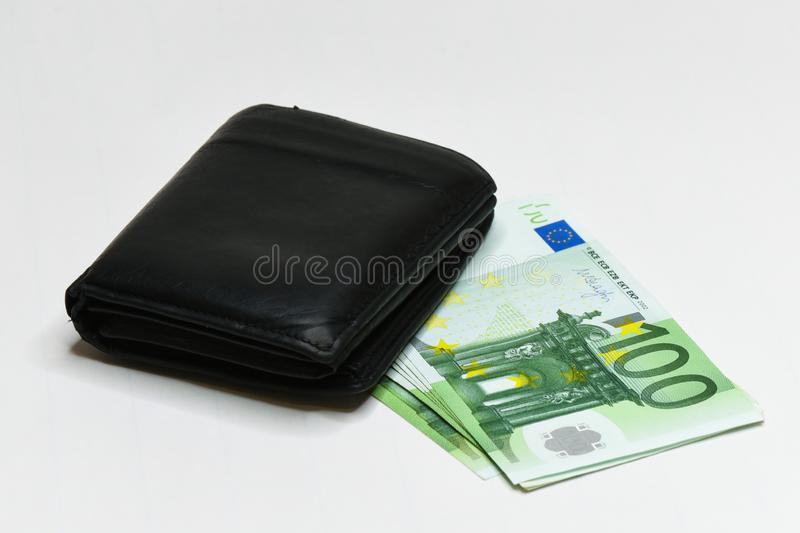 Euro money banknotes and wallet. isolated. Black wallet and 100 euro bills isolated on white royalty free stock photography