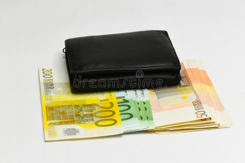 Euro money banknotes and wallet. isolated. Black wallet and  euro bills isolated on white royalty free stock photo