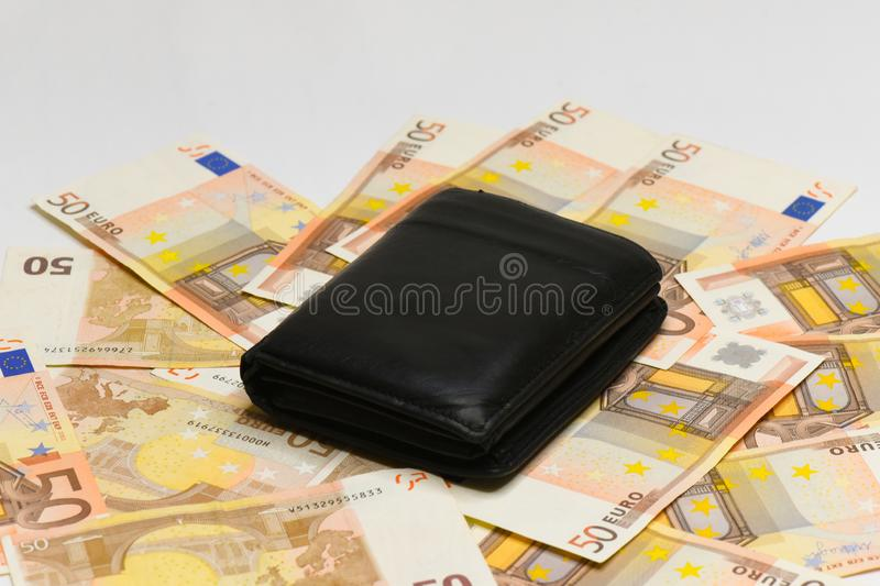 Euro money banknotes and wallet. isolated. Black wallet and 50 euro bills isolated on white background royalty free stock photography