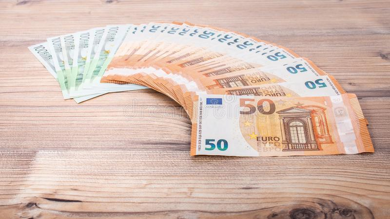 50 euro euro money. Money finance earning sector concept. Cash money on wooden background. .Euro bank notes Laid out in a semicirc. Euro banknotes. 50 euro euro stock photos