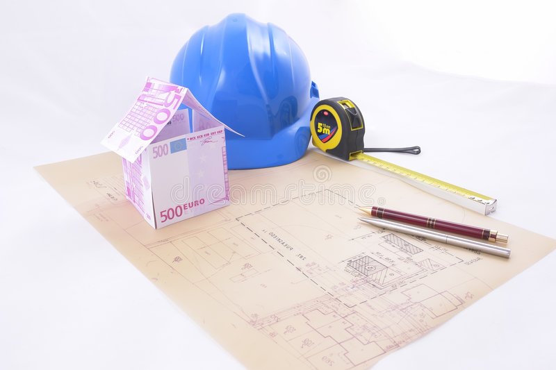 Euro money and house plans stock photo