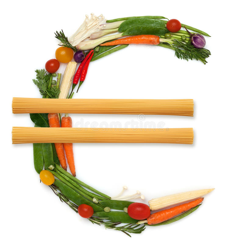 The price of health. The euro money sign made of fresh healthy raw vegetables with two piles of noodles in the middle stock photo