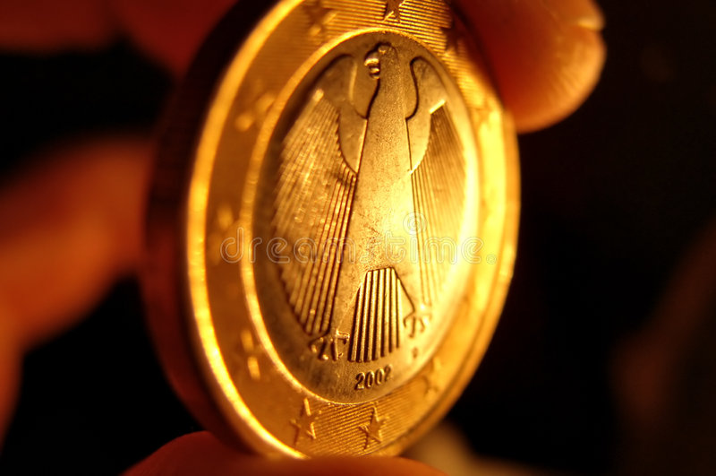Euro muntstuk in een hand royalty-vrije stock foto's