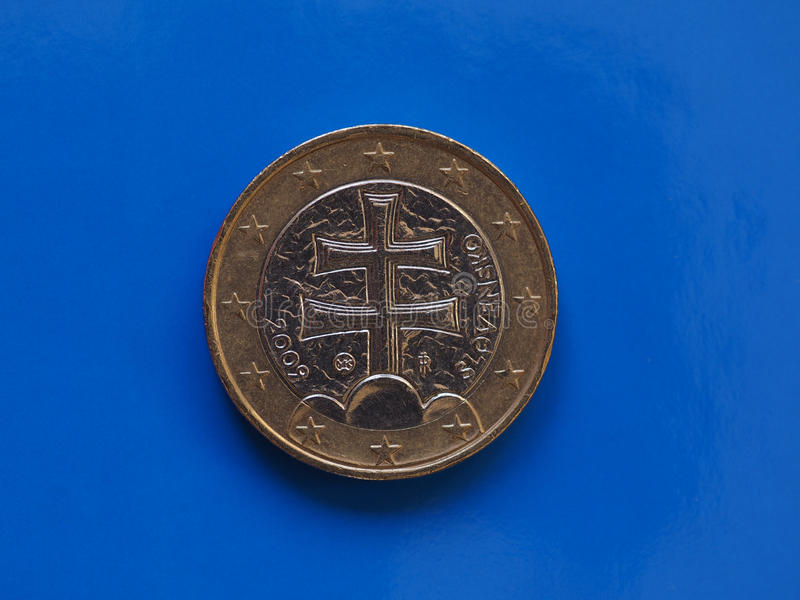 1 euro muntstuk, Europese Unie, Slowakije over blauw royalty-vrije stock foto's