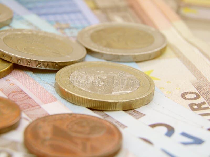 Euro- notas de banco e moedas da moeda imagem de stock