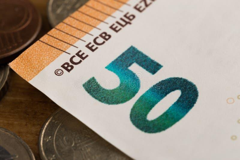 50 euro- notas e imagem das moedas imagem de stock