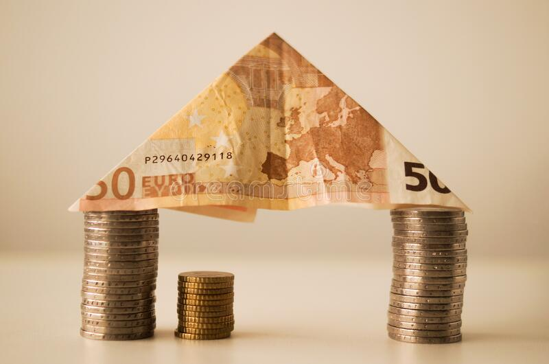 Euro note and coins royalty free stock photography