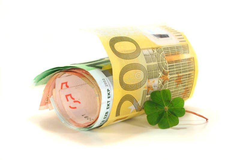 Euro note con il trifoglio immagine stock