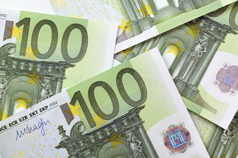 100 euro notes. Overlaid background royalty free stock image