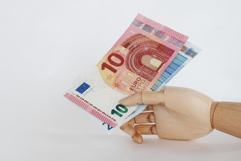 Euro notes in wooden hand-1 stock photography