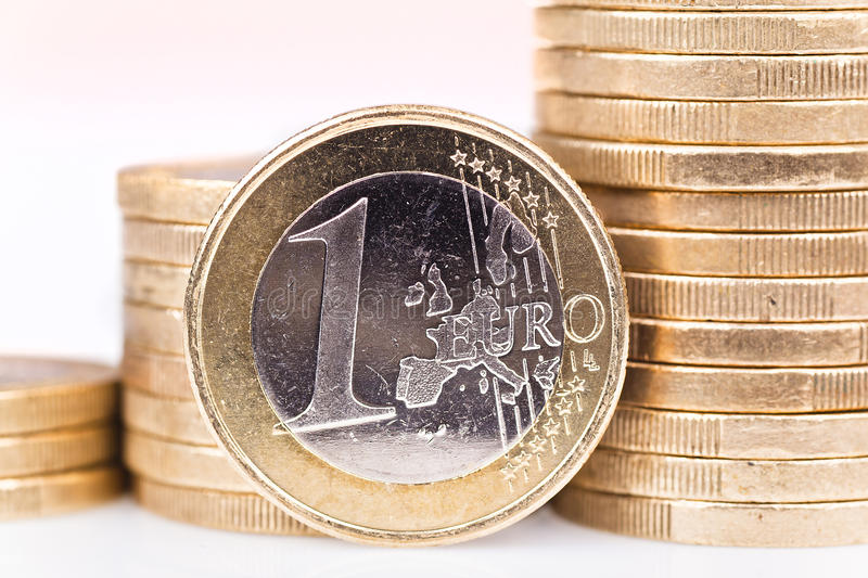Euro. One euro coin and staple of coins royalty free stock images