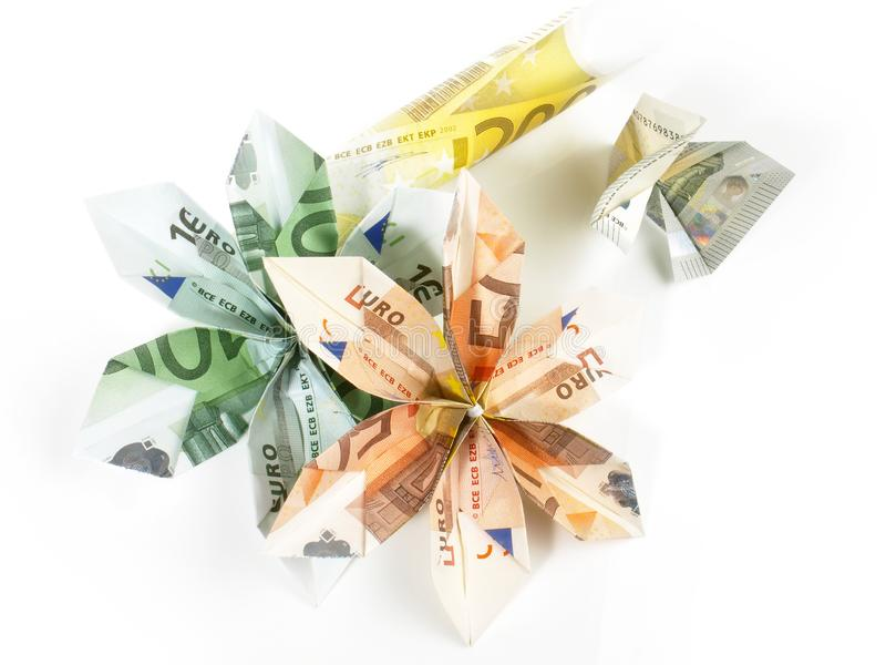 EURO Origami Money. Blossoms on white Background royalty free stock photo