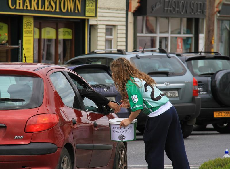 Ireland/Charlestown: Collecting Donations. Young people in Charlestown/Ireland collect donations from passing motorists for their local soccer club/team. The royalty free stock image