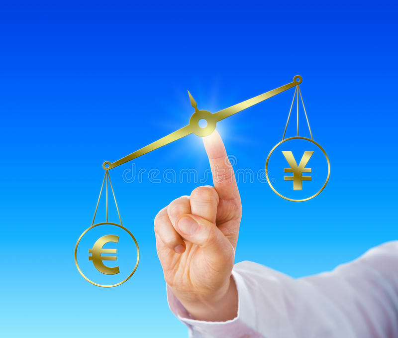 Euro Outweighing The Yen Sign On A Golden Scale. Index finger of a trader is operating a golden virtual pair of scales on which the Euro currency sign is royalty free stock photo