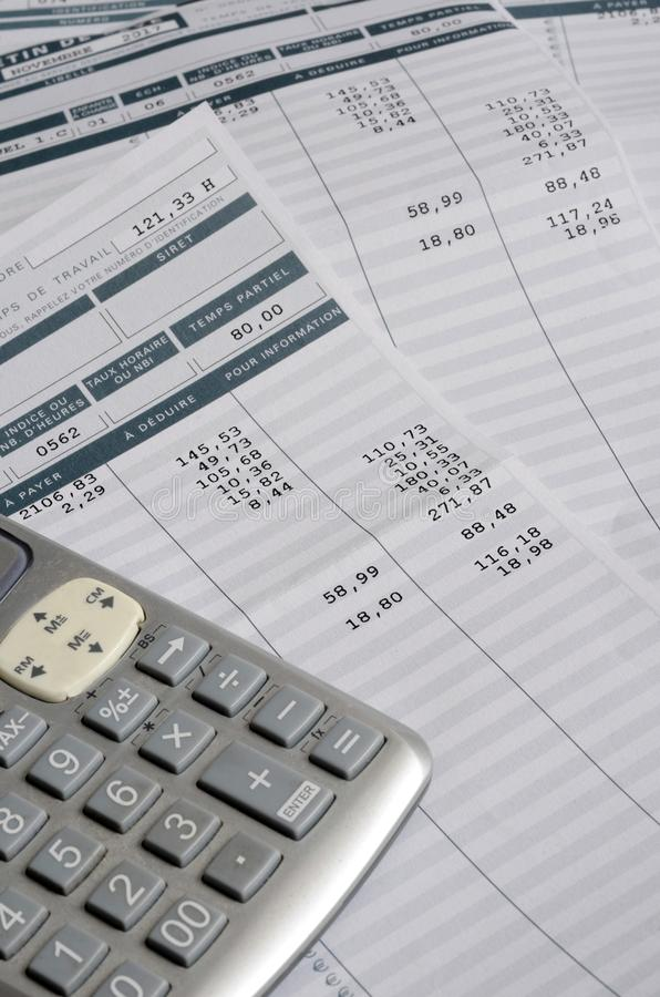 Euro Pay slip and calculator. Close up for payroll or salary background, french mention Net to pay stock photo