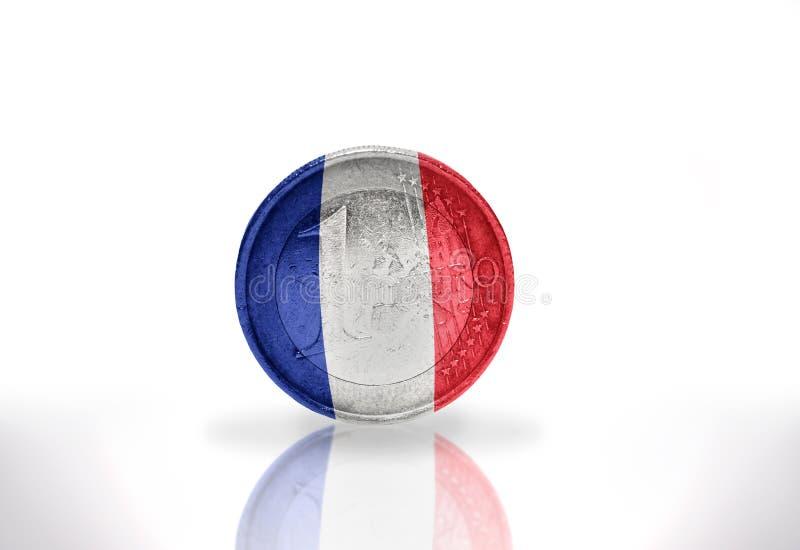 Euro pièce de monnaie avec le drapeau français sur le blanc image libre de droits