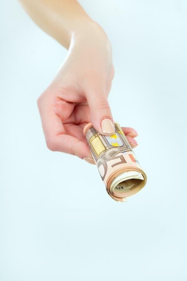 Euro pieniądze w rękach dziewczyna na szarym tle obrazy royalty free