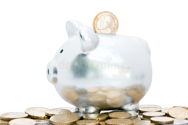 Euro in piggy bank slot royalty free stock photos