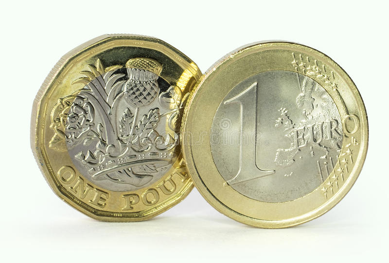 Euro and pound coin royalty free stock image