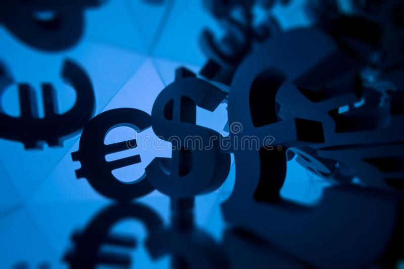 Euro, Pound and Dollar Currency Symbol With Many Mirroring Images. Of Itself on Blue Background royalty free stock photos
