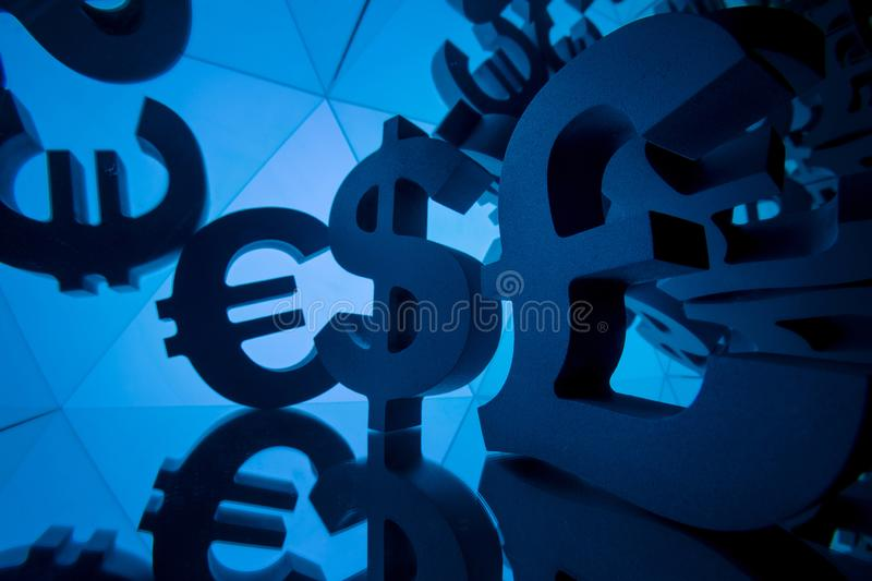 Euro, Pound and Dollar Currency Symbol With Many Mirroring Images. Of Itself on Blue Background royalty free stock photography