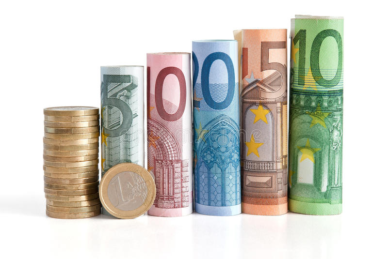 Euro Rolled Bills And Coin Stock Photography