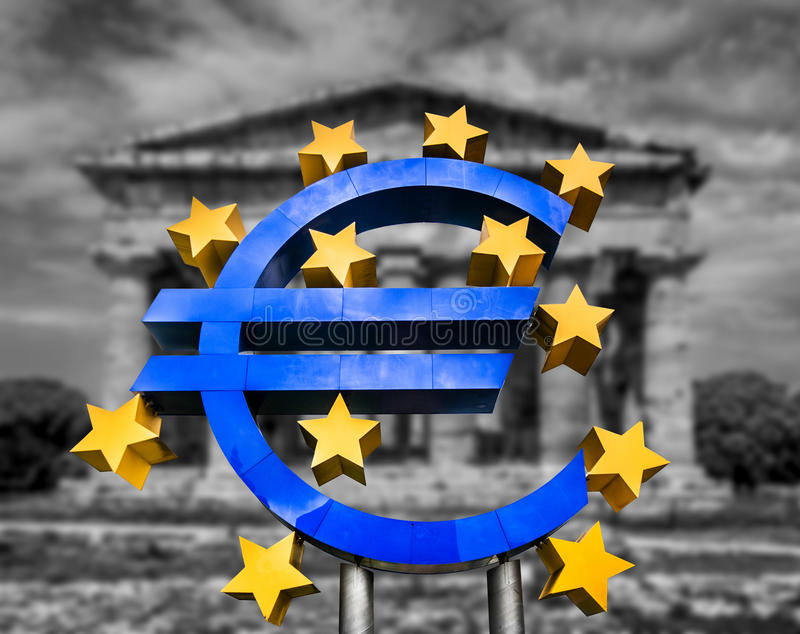 Euro sign in front of Greek temple in black and white. Euro sign on abstract blurred background of a Greek temple in black and white symbolizing a financial stock photos