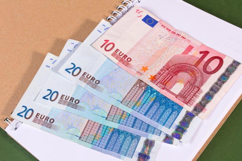 Euro soldi in taccuino fotografia stock libera da diritti