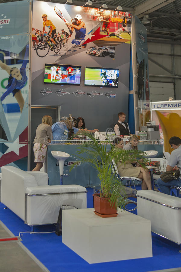 Euro Sport Broadcasting company booth. Visitors visit Euro Sport Broadcasting company booth at Kyiv International TV and Radio Fair 2013 in Kiev, Ukraine. It is royalty free stock photo