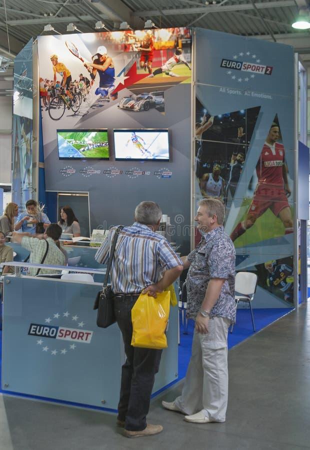 Euro Sport Broadcasting company booth. Visitors visit Euro Sport Broadcasting company booth at Kyiv International TV and Radio Fair 2013 in Kiev, Ukraine. It is stock photo