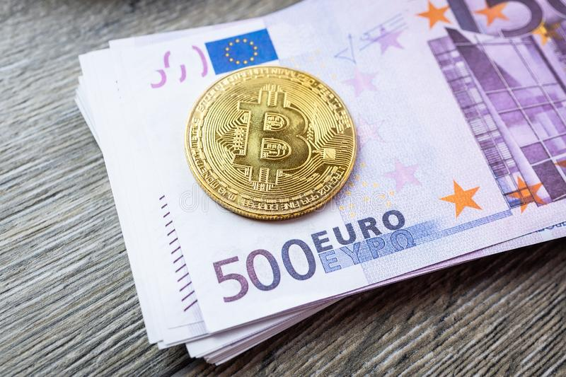 Euro und Bitcoin stockfotos