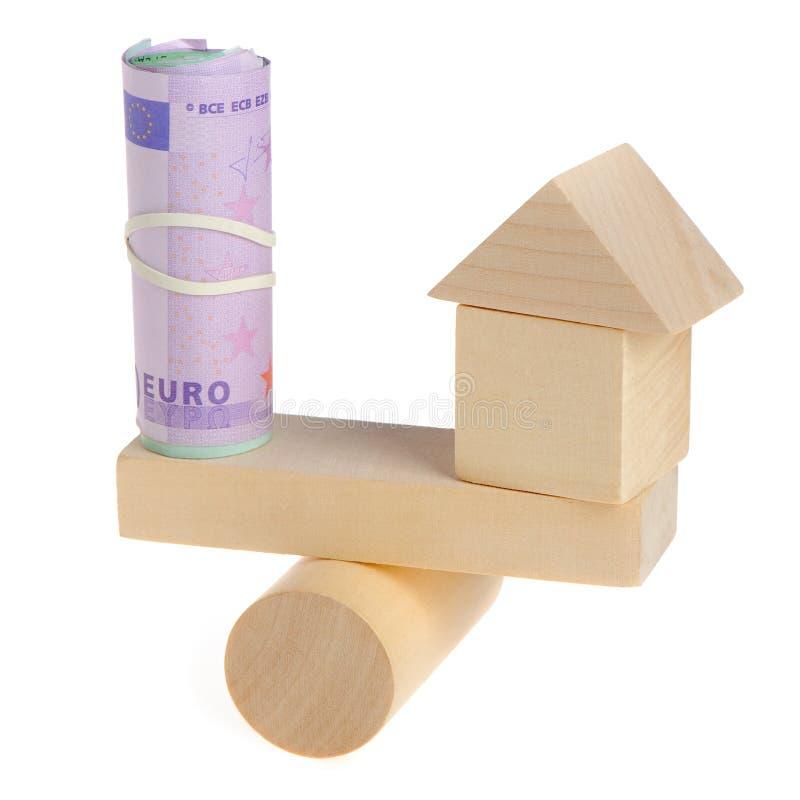 Euro- und Spielzeughaus stockbild
