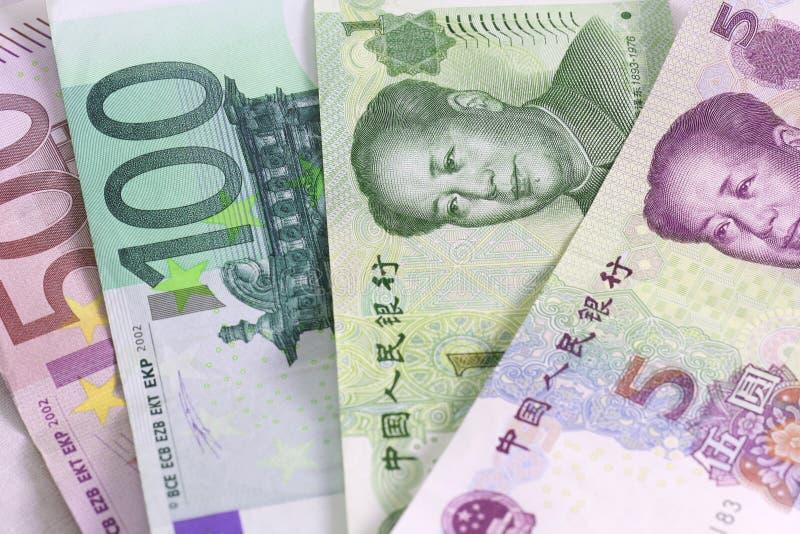Euro versus Yuan stock fotografie