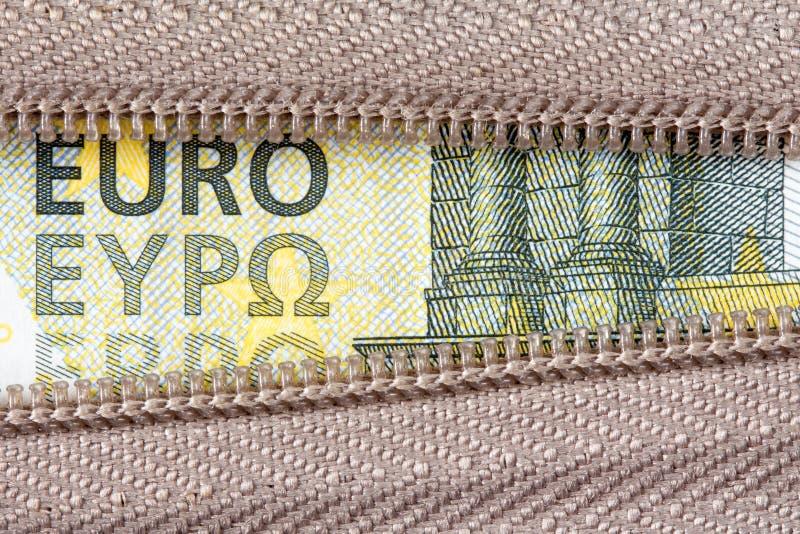 Euro vijf en ritssluiting stock foto's