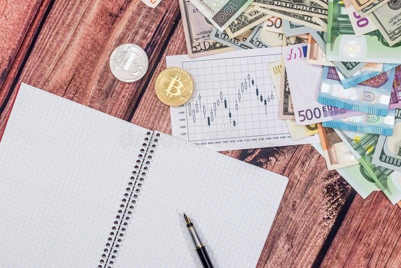 Euro vs dollar with notepad, coin, pen. On desk royalty free stock images