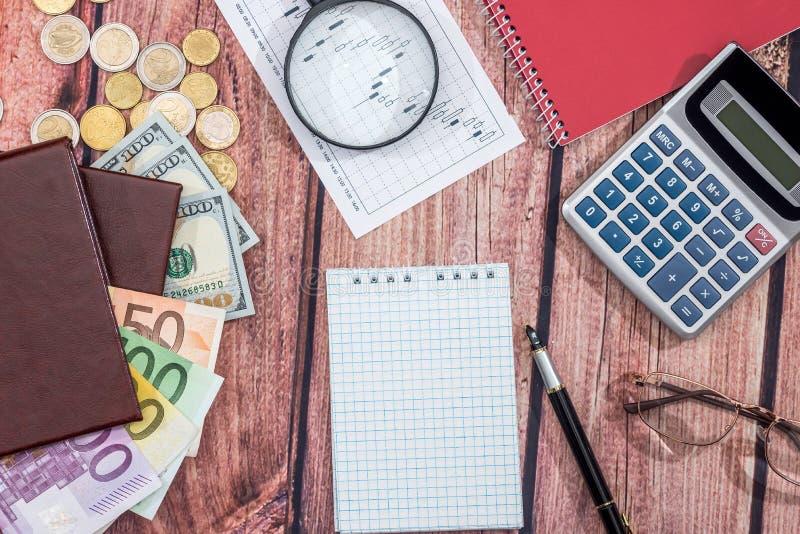 Euro vs dollar with notepad, coin pen. Euro vs dollar with notepad, coin, pen on desk royalty free stock photos